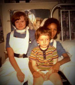 SB aged 7 with 2 nurses